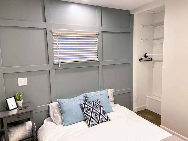 This bedroom might be small, but it's mighty. Room in the closet to hang or fold your clothes, windows on either side for lots of sun light and a bedside table to hang up your book at night.