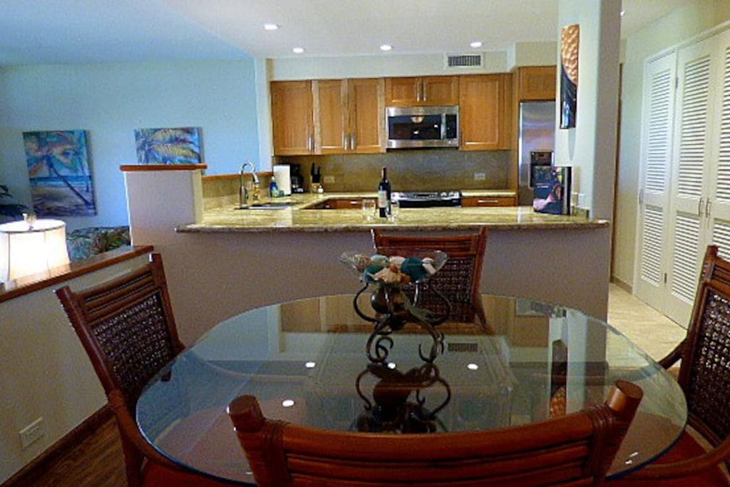 Upgraded kitchen with granite countertops and stainless steel appliances.