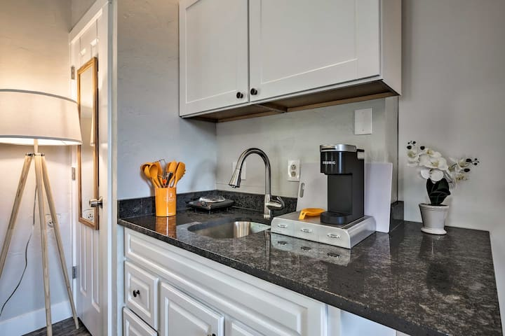 The kitchenette also features a hot plate and a Keurig.