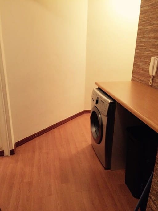 The apartment is fitted with a washer & dryer.