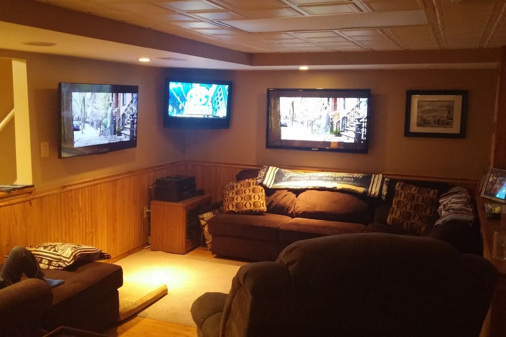 Finished basement for the sports enthusiast...55 inch/ 32 inch/ 55 inch TV's ! built in adjustable surround sound.