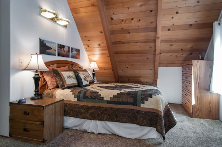 The master bedroom is upstairs and has a balcony for you to enjoy the serenity of Tahoe.