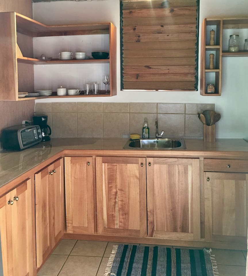Fully equipped kitchen with 4 burner stove and oven