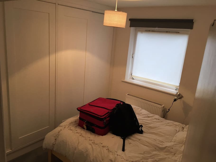 Nice comfy king size bedroom with a big empty cupboard all to yourself...