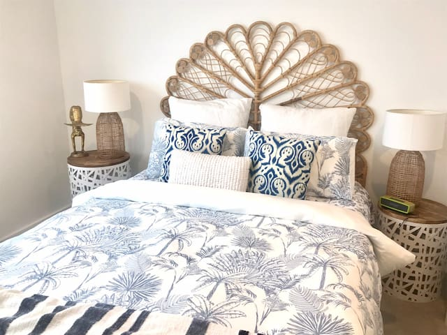 Comfy bed with beautiful linen, decor, ocean views & large walk-in robe.