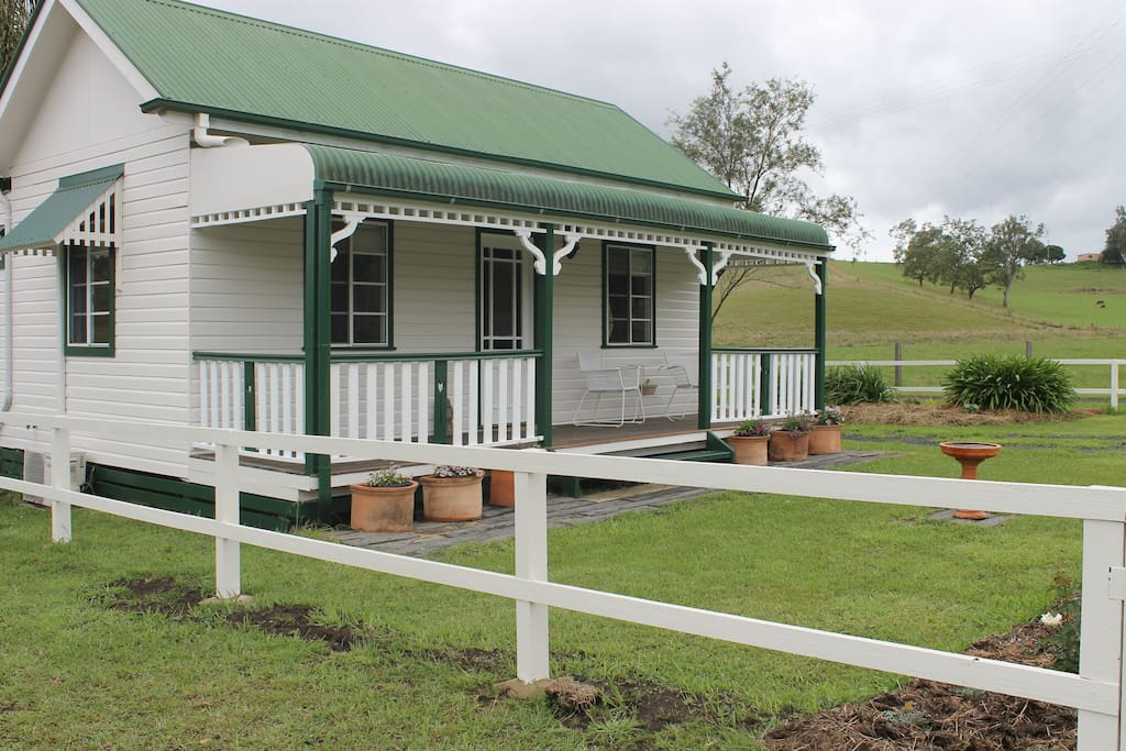 The south facing front verandah offers a cool private place to relax in the warm weather