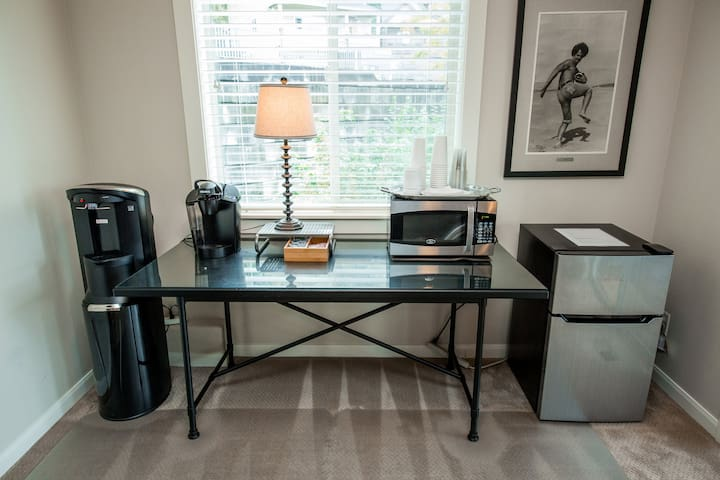 Glass top prep table doubles as work table