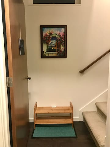 The studio is up the stairs on the right. Shoe rack downstairs for wet things. It occasionally rains in Seattle. :)