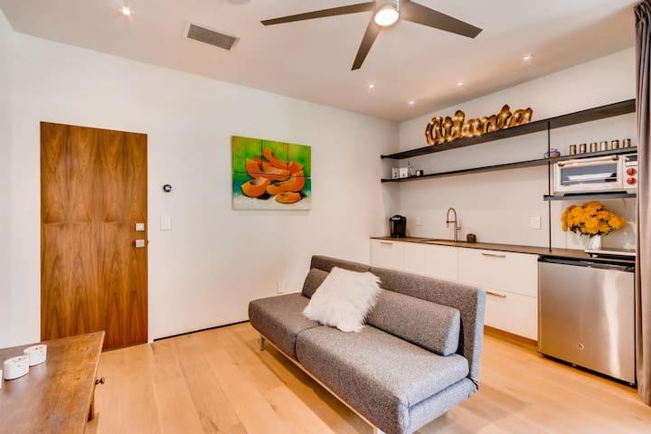 Kitchenette has sink, fridge, microwave, Keurig coffee maker, water cooker