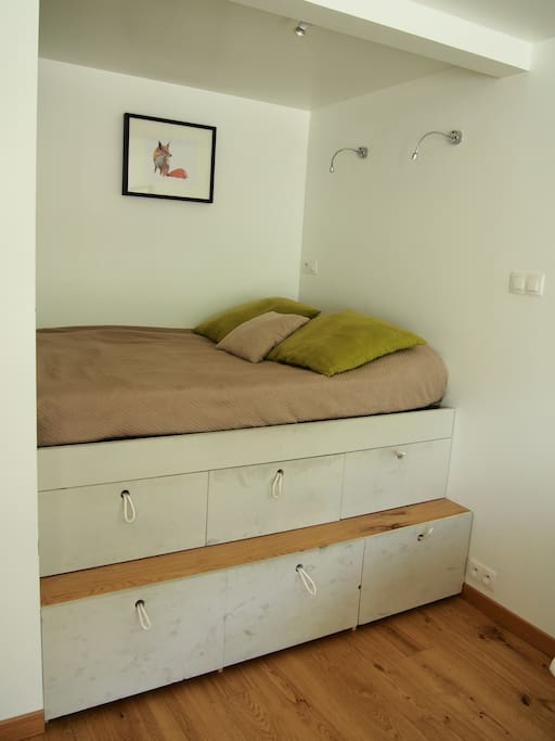 A comfortable 140x200cm bed fits 2 people and is custom built up on 6 big storage drawers that guests are welcome to use for clothes, bags, gear etc.