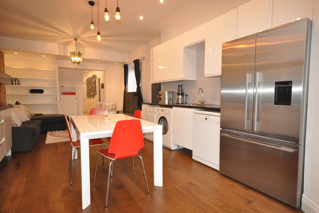 Open plan kitchen and living space with large fridge freezer