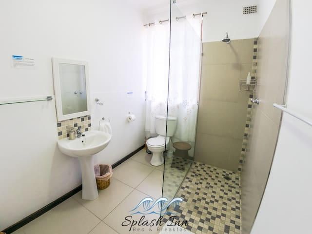 En-suite Bathroom with shower and toilet