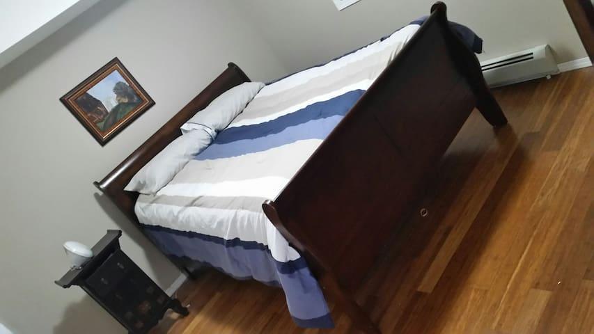 Raised queen sleigh bed in master bdrm