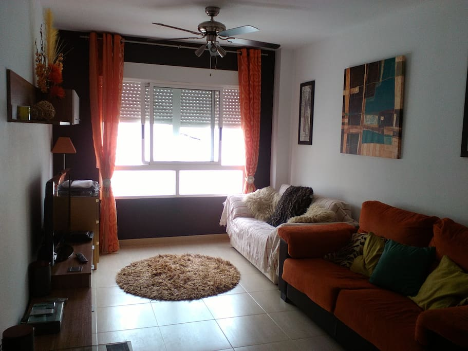 Lounge with ceiling fan and two comfy sofa beds LCD tv and cd player