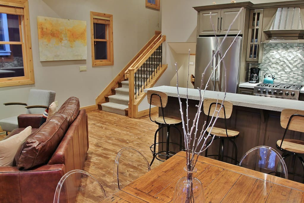 Dining room adjacent to kitchen and living room with 6-seat dining table- Park City Resort Estate