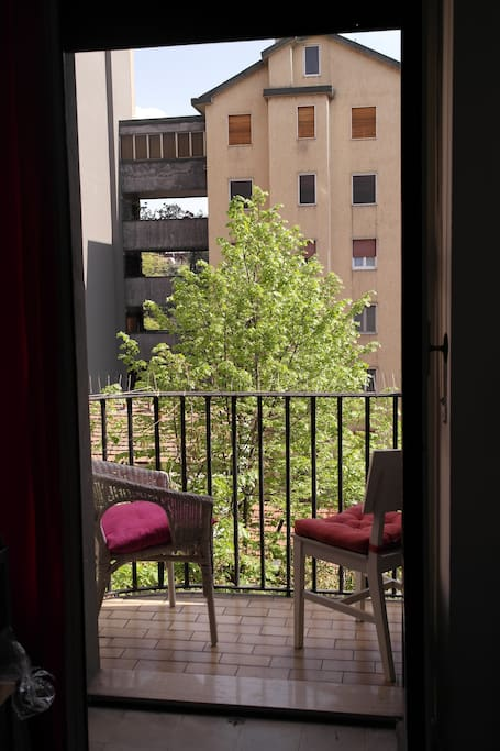 a balcony with a view to the building yard