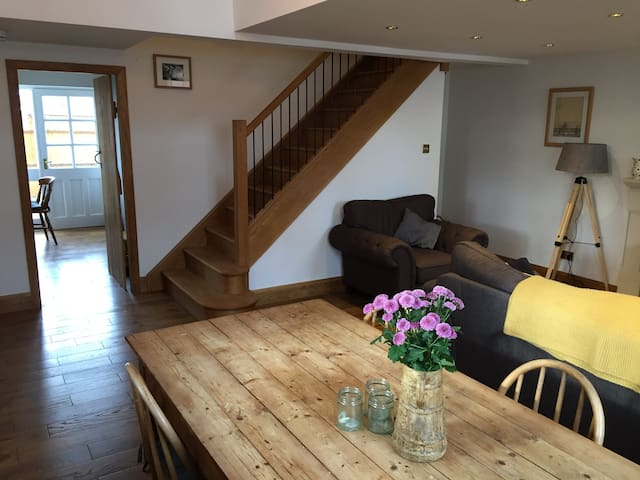 solid oak staircase and pine dinning table