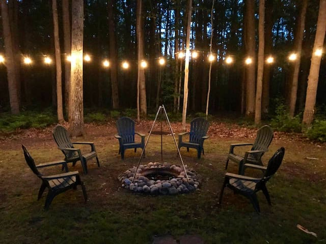 Fire pit with cooking grate and lighting
