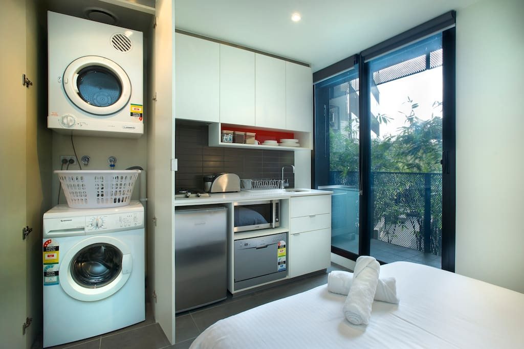Washing and dryer are available. Fully equipped with kitchen and cooking amenities.