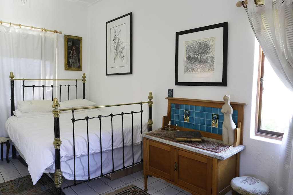 Double bed, nice light with view of Table Mountain.