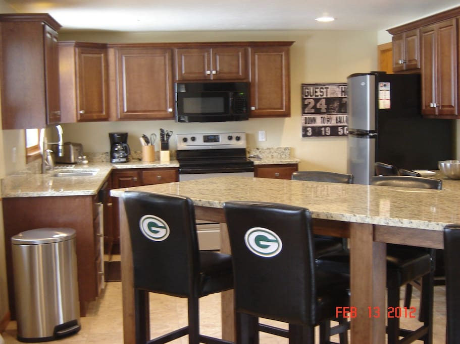 Large bar and view of the kitchen. House is all completely remodeled.