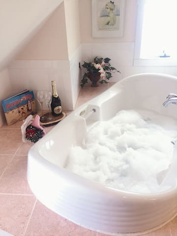 Luxurious Two person Jacuzzi and large separate shower.