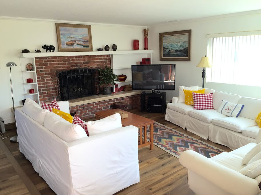 Comfortable seating  for 8-10 people around cozy gas fireplace.