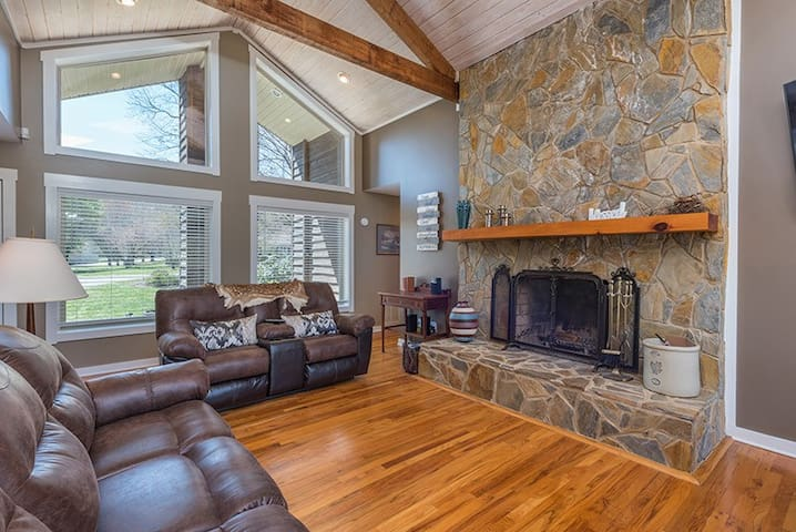 Living room with wood-burning fireplace