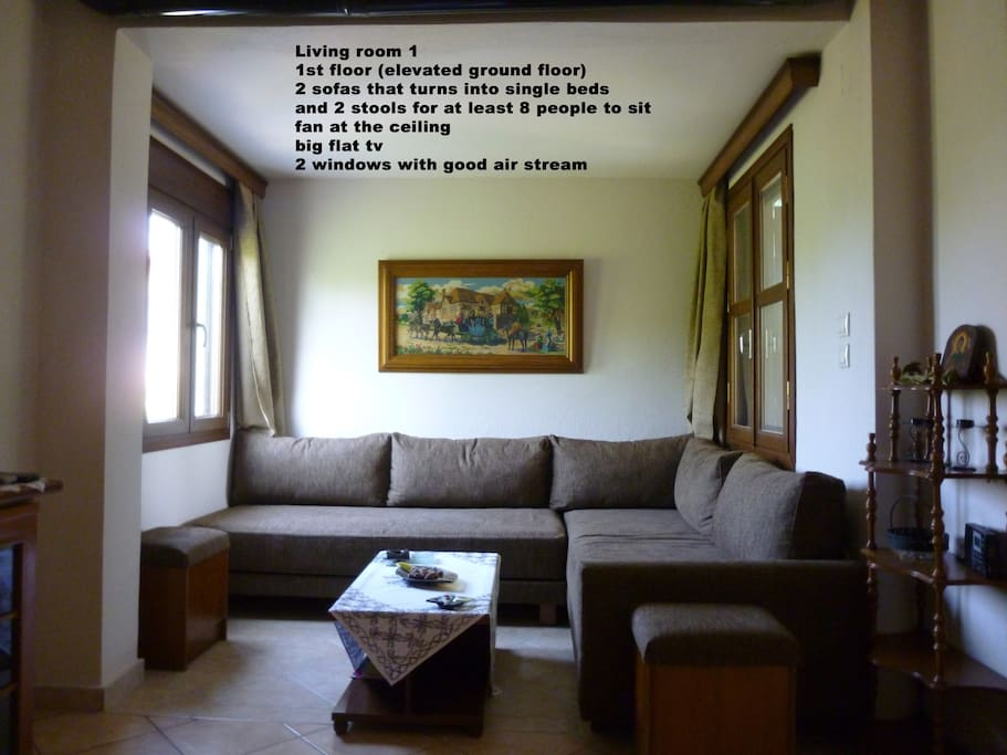 Big living room on the elevated ground floor that turns into 2 single beds