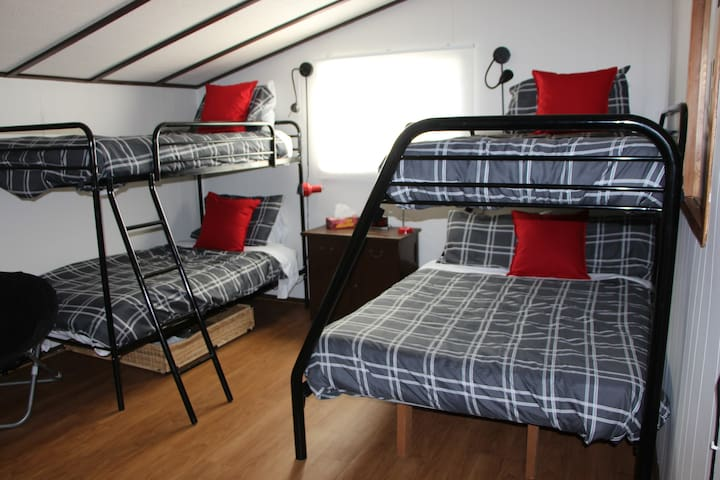 The Bunkhouse room on second floor can sleep at least 5 and has a TV with gaming systems, DVD and movies.
