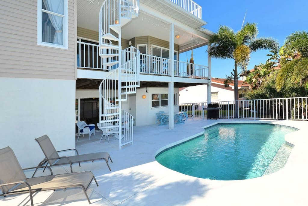 Lots of outdoor seating and lounging areas.  Grill is perfect for  a poolside barbecue