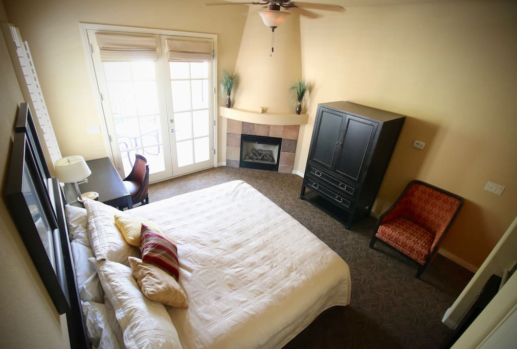 Spacious Master Suite has its own wetbar and microwave. TV inside armoire.