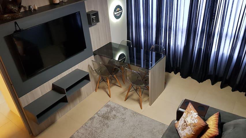 Apartamento com suite e garagem no centro