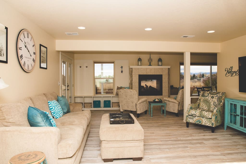Large living area with comfy seating and beautiful views!  The chairs can be moved for cozier arrangements and the recliners by the fireplace are perfect for morning coffee or evening wine.