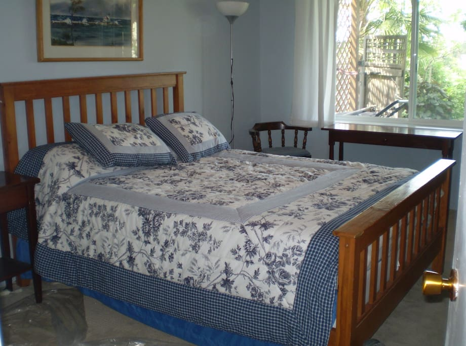 Generous bedroom with queen bed and view to Olympics