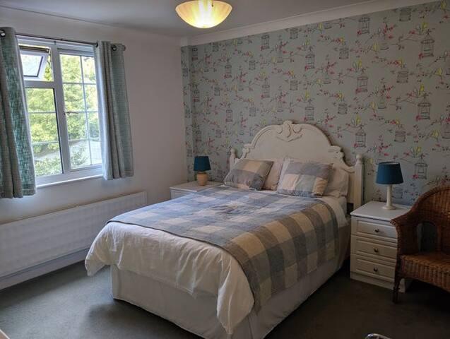 Main bedroom with garden view.