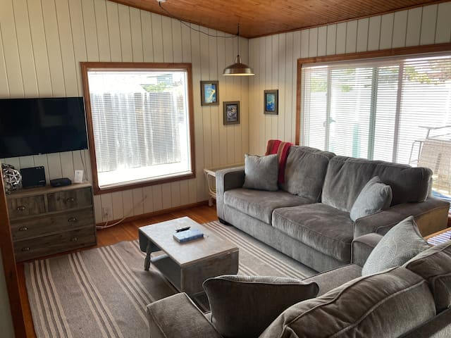***June 2021 Update*** New couch and love seat for guests to cozy up and enjoy watching TV or playing games with the family. The couch is a pull out sofa bed. We provide sheets and blankets for the pullout.