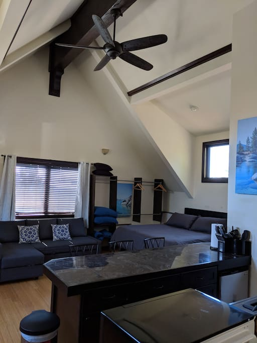 High-vaulted ceilings make this already large studio feel even more spacious. A Cal-King bed with brand new memory foam mattress and Ikea sofa that easily converts into a queen size bed with comfortable topper for additional guests.