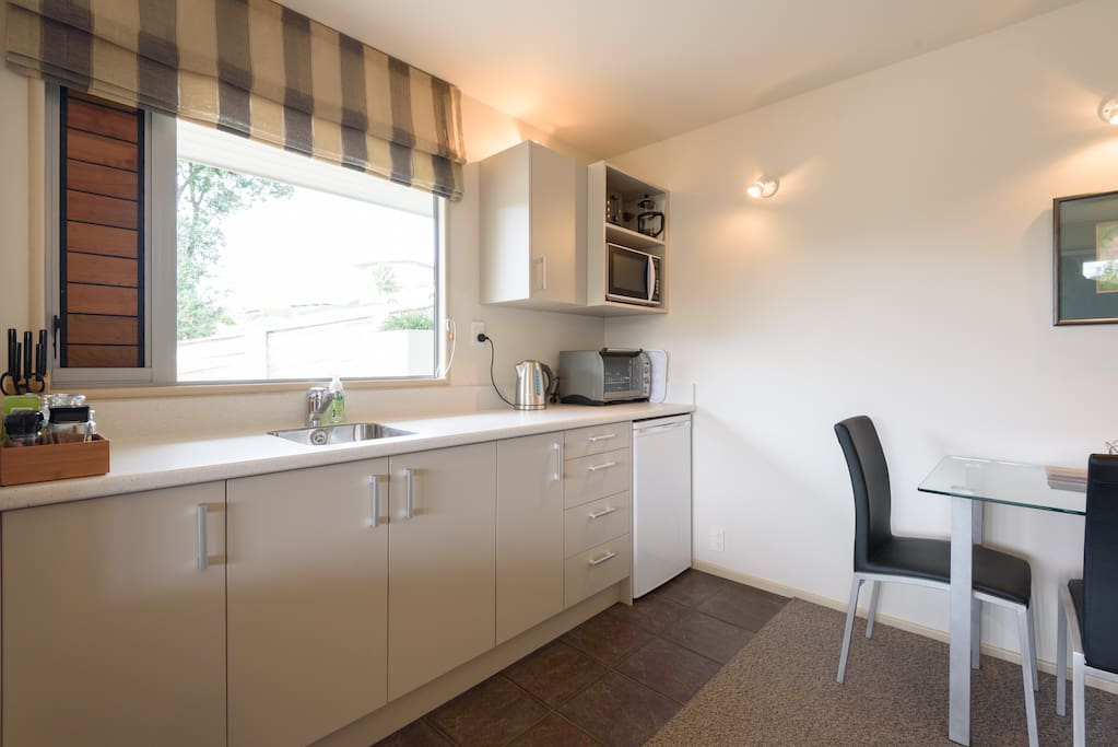 Well equipped kitchenette with bench top oven and microwave.