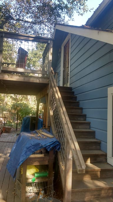 back deck showing stairs and private entrance.