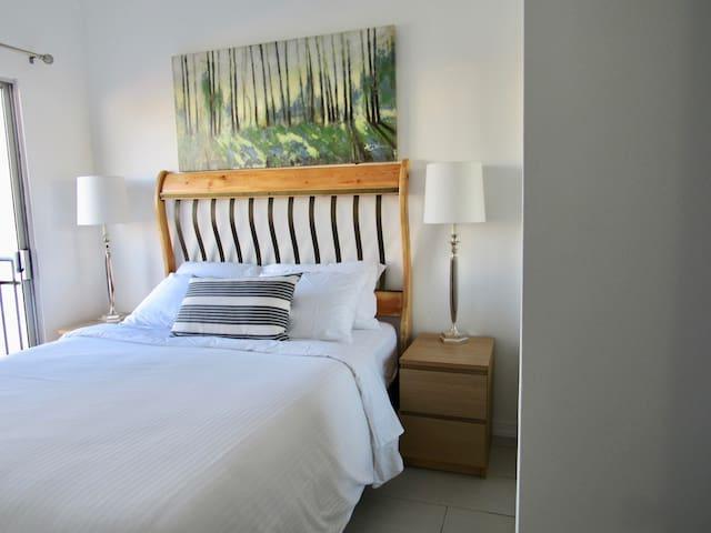 Master bedroom w/ Queen bed & TV