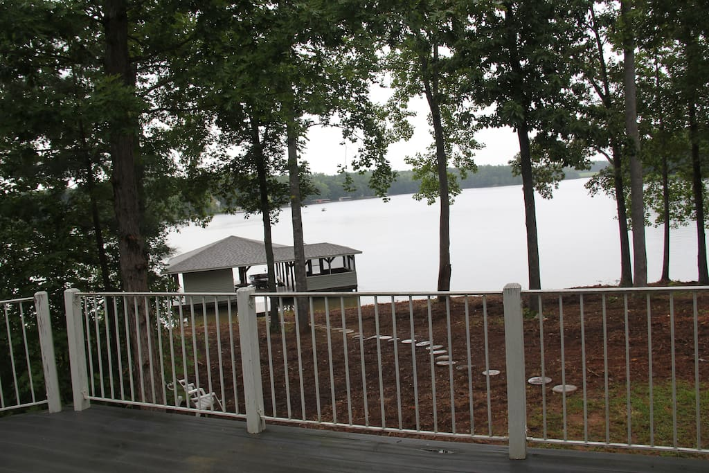 View from the house deck, boat house and lake.