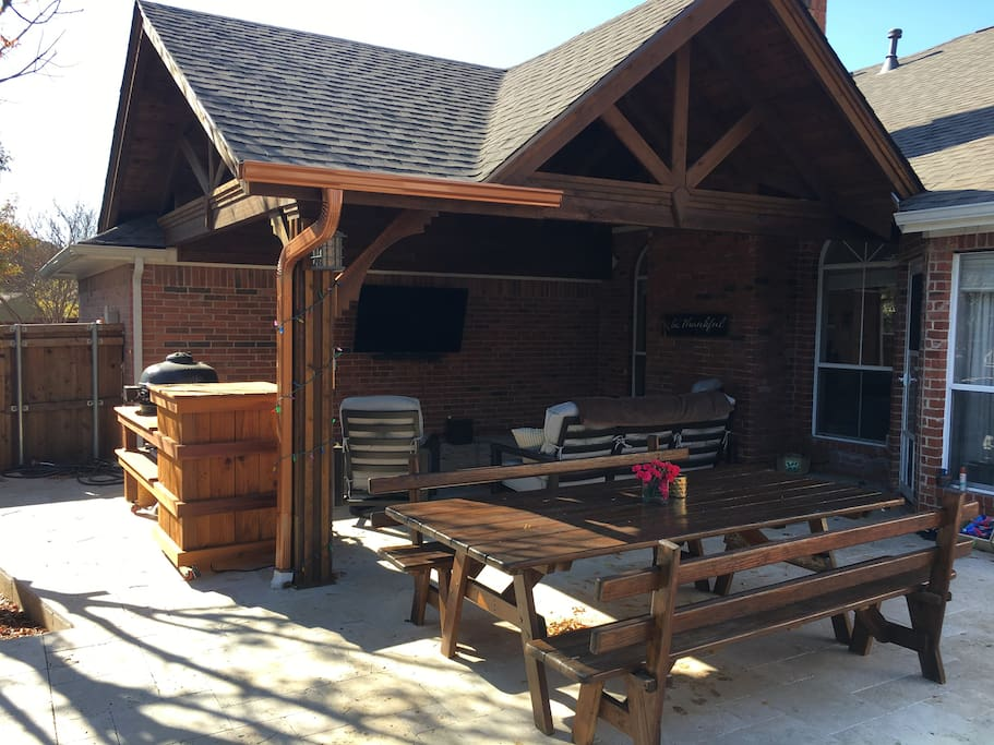 Family style picnic table and our outdoor living area.
