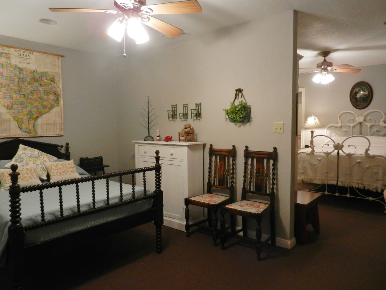 The two bedrooms downstairs are separated by only a wall.  The bedrooms and living area is separated by a door.