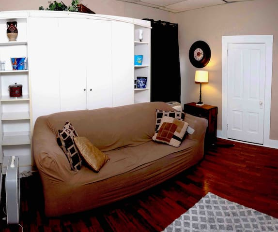 Murphy bed behind couch