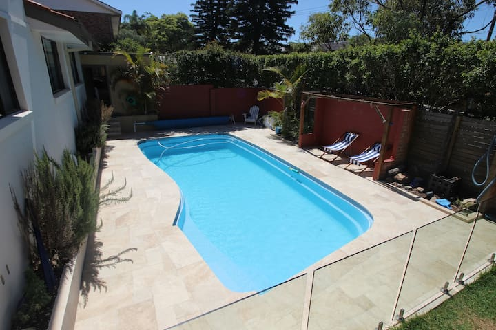 Travertine tiling around the pool area, relax in the deck chairs or go for a swim!