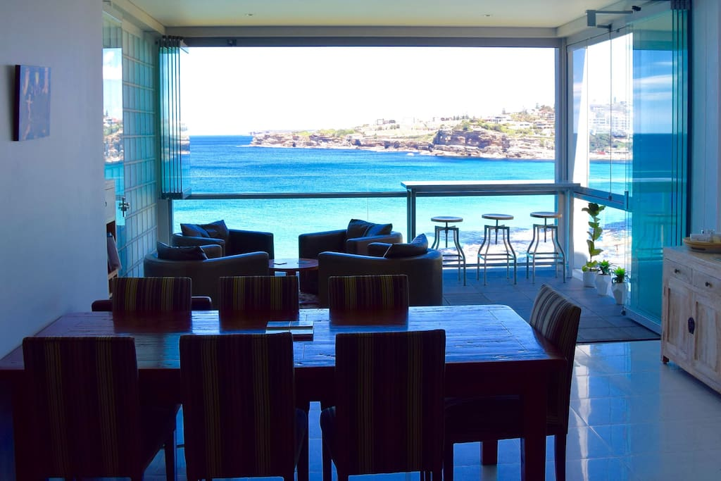 Open plan living, dining and kitchen, all enjoying the stunning ocean views.