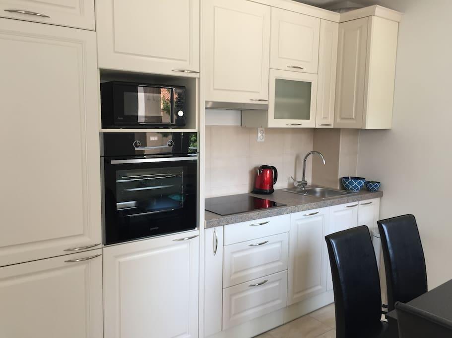 Custom kitchen with new, modern appliances