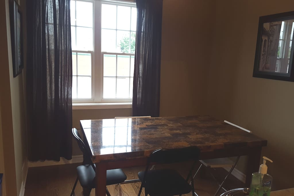 dining room. open concept and cathedral ceilings