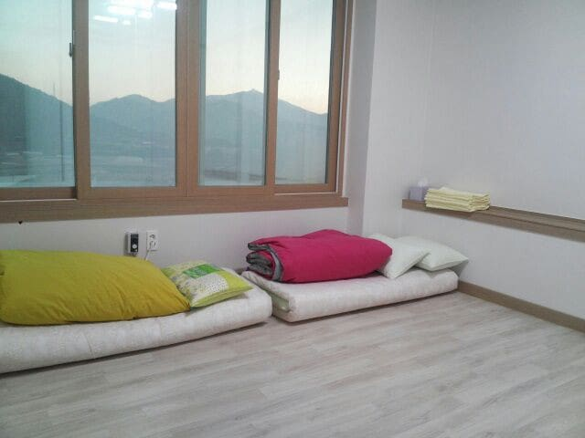 Bedroom. Can fit two queen size floor.mattresses. Our heated floor makes sleeping warm, even on a cold night.